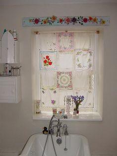 Delicate curtain made of vintage hankies