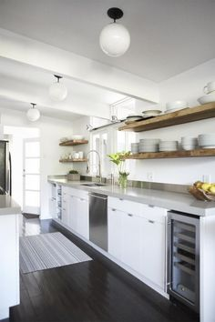 Notice there are no dish cabinets! It lets the walls look more open and the room spacious.