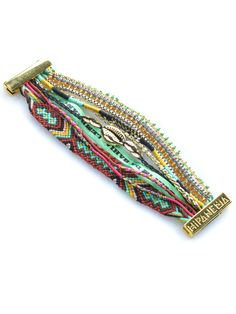This bracelet has it all: - Magnetic clasp - Woven threads - Stones  - Coins -& Beads!