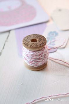 wooden spool + pink bakers twine