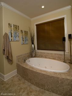 The Rochelle - Plan 1204. Soaking tub in the master bathroom. http://www.dongardner.com/plan_details.aspx?pid=3506. #Master #Bathroom #Tub