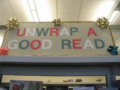 """Unwrap a Good Read"" library Christmas bulletin board. Could wrap books in holiday paper and bows for a ""blind read."""