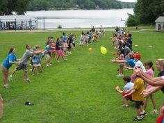 Summer Camp Enjoying A Game Of Water Balloon Toss