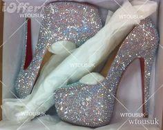 Google képkeresési találat: http://cdn102.iofferphoto.com/img3/item/520/107/727/newest-luxury-style-silver-crystal-pumps-wedding-shoes-bf38.jpg
