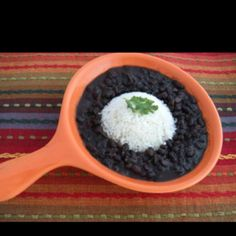 """Frijoles Negros (Black Beans)  When it comes to beans, blacks ones are on the top of my list. I learned how to make them from a very old and dear friend. I was shocked to learn that you really don't need much to bring the flavors out. """"Keep it simple"""", she always said.   Ingredients:   1 pound package of dried black beans 3 bay leaves 4 cloves of garlic 1 large green bell pepper, cut in quarters ¼ cup of sofrito  1 large onion, peeled and leave whole 3 tablespoons of ground cumin Salt and pep..."""