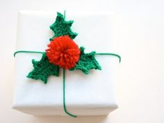 Holly Berry Gift Wrap Tutorial - Add a homemade touch to your Christmas gifts this year by wrapping them with your very own crochet patterns!