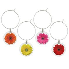 Set of gerbera daisy flower wine charms. This set of 4 gerber daisies wine glass charms would make a great wedding gift or a fun way to decorate the head table at the wedding.