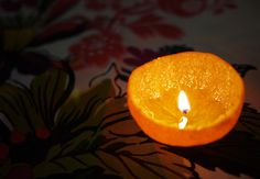 Orange Peel Candles. Could be cool for a dinner party or outside on a summer evening.