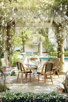Outdoor entertaining under a pergola with Ballard Designs and Domino magazine