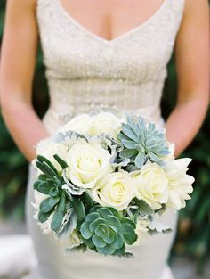 Lazaro Wedding dress  and gorgeous succulent and white rose bouqet | Photo by Daniele Rose |