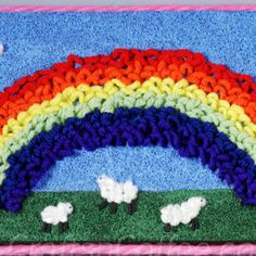 Loopy Yarn Rainbow -- this is an amazingly creative way to use yarn! Crafts for kids are so innovative!!