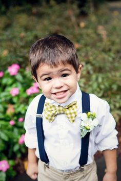 Ring bearer with gray pants and a blue Bow tie