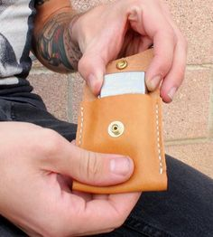 It's a wallet. For your zippo. It needs a wallet. (partner)