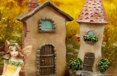 Tiny fairy houses in the fall fairy garden.