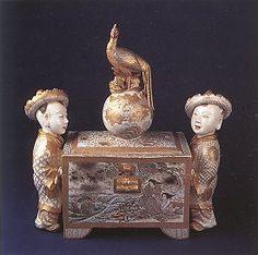 Extraordinary Satsuma casket with peacock and orb finial on pierced cover and flanked by a pair of figural youths. Painted decorations of figures in landscapes, anonymous, c. 1870-1880