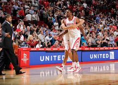 Luis Scola celebrates with Patrick Patterson after a big shot vs. Sacramento