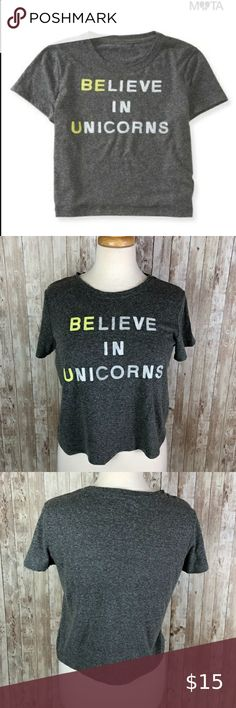 "Bethany Mota Believe in Unicorns Be U Tee t-shirt Love this longer cropped tee! Bethany Mota's inspirational ""Believe in Unicorns"" with ""Be U"" highlighted in bright neon yellow from Aeropostale. Neon green accent trim down the side seams. Perfect for summer, it screams to be paired with distressed jean shorts and your favorite sandals.   Measurements when laid flat: armpit to armpit: 20"" length: 19"" bottom opening: 19""  70% polester/30% cotton -wash in cold Bethany Mota Tops Tees - Short Sleeve"