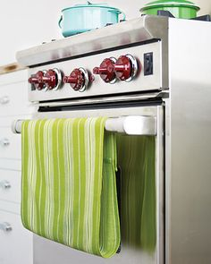 Velcro on kitchen towels so they don't fall off!