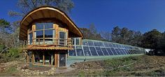 Driftless Farm Greenhouse, Wisconsin. A 2800 s.f. straw-bale insulated solar greenhouse. Whole tee supports made from site-harvested black l... the larger the pit system, the more stable the temps