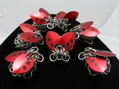 Chainmail Ladybugs! Really creative!  Garret barettes?