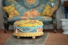 The little pouf ottoman in the pic with the sofa was made using the cardboard tube from a roll of ribbon.