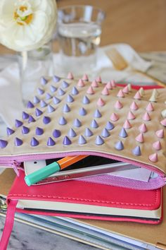 Spiky-chic: DIY studded zipper pouch.