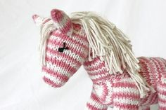 My friend makes these and sells them on Etsy.  Check them out... Hand Knit Pony Horse - Strawberry Shortcake