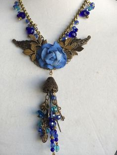 Blue fantasy wings and beads by Gloria Allen Designs