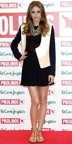 05/08/13: Olivia Palermo presented the latest Pikolinos collection in a black ensemble that she teamed with a colorblock topper, oversized necklace and braided sandals. #lookoftheday