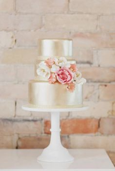 Shimmering metallic and floral cake.