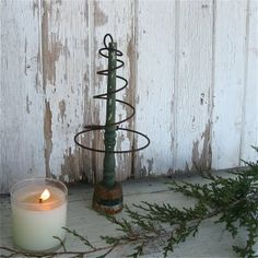 Primitive tree from a bed spring and a spool.