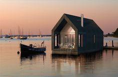 Floating Barn: Modest Houseboat Inspired by Sea Shacks