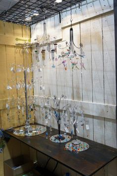 Make your Rainbow Makers counter displays sparkle like diamonds by placing mirrors underneath and showcasing them against a light background. A grid at the top allows you to use your vertical space to its best advantage. Woodstock Chimes booth at the Toronto Gift Show 2014.