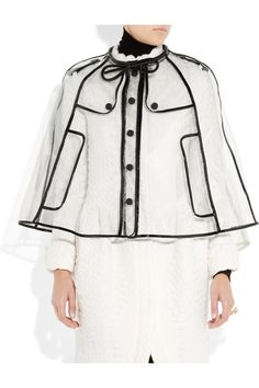 Sure, if I had $1295 laying around, I'd definitely buy this Burberry patent leather-trimmed raincoat. Why not?