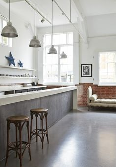 Polished concrete floor - anything low maintenance is fine by me