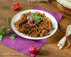 Cochinita Pibil (ko-chi-knee-ta pee-beel) is slow roasted pork from the Yucatan peninsula.