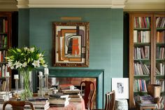 """The library of fashion designer and art collector Kasper's Manhattan apartment is clad in a teal silk wall covering, which is complemented by a green faux-marble fireplace surround with stainless-steel trim..."" [From ""20 Inspiring Green Rooms""]"