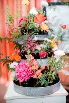 floral arrangements in galvanized cupcake spinners // photo by MegPerotti.com