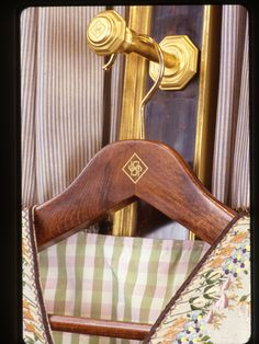 Hanger and pull-out rod with monogram of Howard Slatkin, from FIFTH AVENUE STYLE.