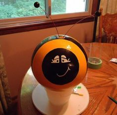 DIY & Crafts: Bowling Ball Yard Art (Bumblebees) This could make a cute cache, with the addition of a bison tube in a finger hole.