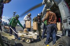 PHILIPPINE SEA(Nov.15,2013)Sailors aboard aircraft carrier USS George Washington (CVN 73) load containers of fresh water onto MH-60S Sea Hawk helicopter from Golden Falcons Helicopter Sea Combat Squadron (HSC) 12 for delivery ashore in support of Operation Damayan.George Washington Strike Group supports 3rd Marine Expeditionary Brigade to assist Philippine government in response to aftermath of Super typhoon Haiyan in the Republic of the Philippines.(USN Mass Comm Spec 2nd Class Trevor Welsh)