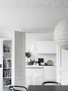 white tile, white cabinets