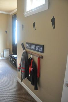 "Hockey Stick Wall Hooks and ""It's All About Hockey"" Sign Set by Homeworks Etc.- LOVE this!"