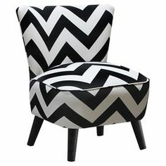"Accent chair with black and white chevron upholstery and matching piped trim. Handmade in the USA.   Product: ChairConstruction Material: Wood frame and fabric seatColor: Black and whiteFeatures:   Contemporary zig zag printCone legsHandmade in the USA Dimensions: 32"" H x 23.5"" W x 25"" D Cleaning and Care: Spot clean only"