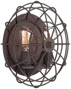 I love the industrial feeling of this Franklin Iron Works Cage sconce. It reminds me of this old metal fan that my grandparents used to have. #EUW7991 - Euro Style Lighting
