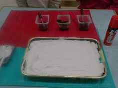good setup for marbling paper with food coloring and shaving cream