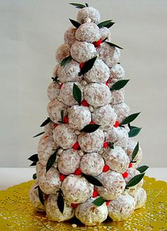 Doughnut-Hole Christmas tree....  This is great for the sweets table at Christmas parties, especially when there are kids. I use gumdrops, and spearmint leaves as accents.