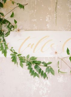 Gold calligraphy on an ivory banner by Ink and Honey, image by Lauren Kinsey. #wedding
