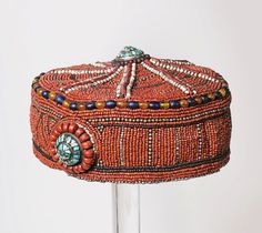 Tibet | Nobelman's hat from the late 19th to early 20th century | cloth, turquoise, glass beads and carnelians  The Mingei seems like it got stuck with many fake headdresses.. LP