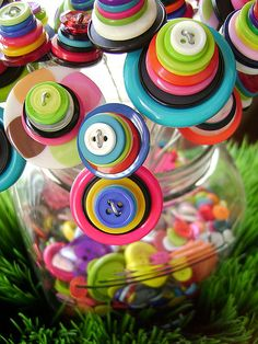 So colorful button flowers in a jar of buttons